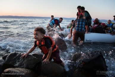 A group of Syrian refugees arrive on the island of Lesbos after traveling in an inflatable raft from Turkey, near Skala Sykaminias, Greece.